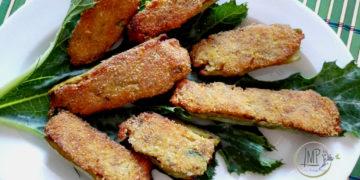 Zucchine ripiene vegetariane alla ligure su piatto e foglia di zucchino