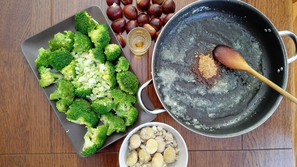 Castagne, broccoletti ingredienti su tavolo